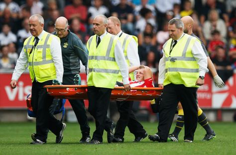James Ward-Prowse of Southampton is stretchered off during the Barclays Premier League match between Swansea City and Southampton at Liberty Stadium on September 20, 2014 in Swansea, Wales.