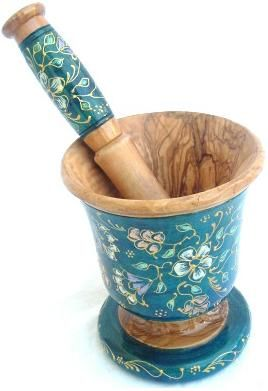 Mortar and pestle collection. Wooden mortar and pestle carved off of natural olive wood. Longneck pedestal shape, individually hand carved, hand painted on the outside with a flowery turquoise permanant finish wood mortars.