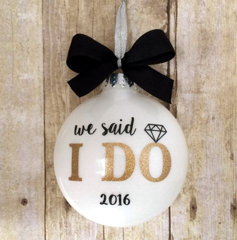 This beautiful We said I Do Ornament features a sparkly white glitter background…