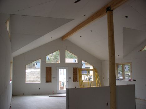 I Love How High This Vaulted Ceiling Is The Wooden Beam Going Through The Peak Of It Too Is A Nice Touch In My Opinion I Remodel Home Remodeling Wooden Beams