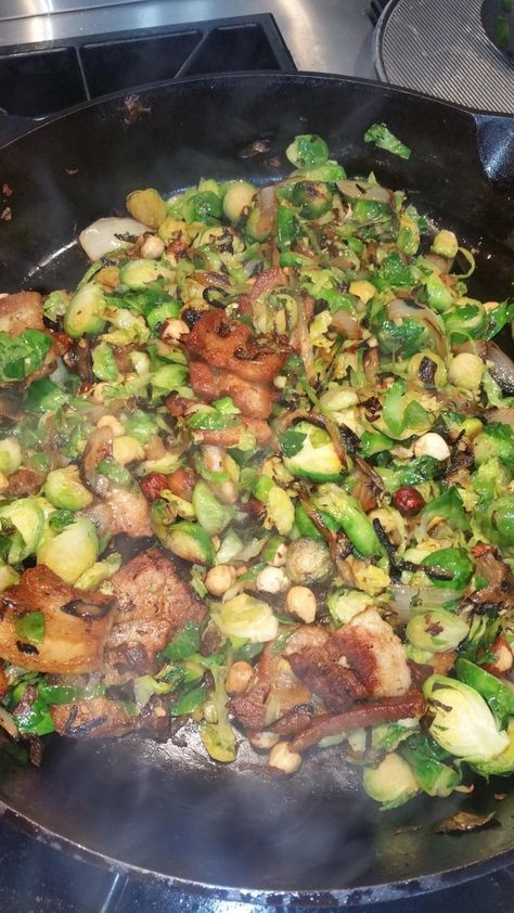 """Brussel sprouts, pork belly, onions & roasted hazelnuts with miso vinaigrette in 14"""" of goodness"""