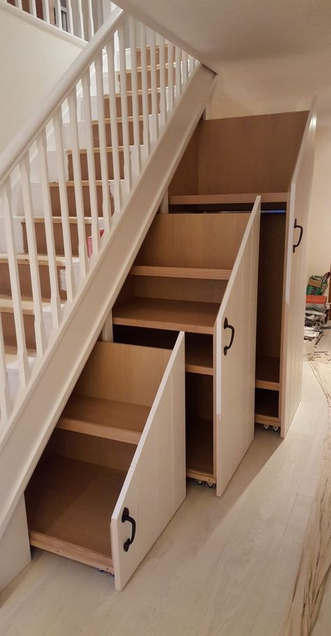 Transform a difficult under stairs space with storage.