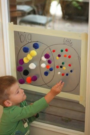 Sticky Learning: pom poms, contact paper, and masking tape.  Sort and learn words/concepts.