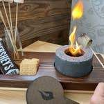 What is it? Meet the on-the-go Ultimate S'MORES Making Kit. Using a cement fire pit designed for interior fires and handmade in Tennessee, these little tabletop pits are perfect for making memories & S'MORES at home or on your next adventure. Just add marshmallows, chocolate & graham crackers for happy campers, picnickers, summer partiers and beachgoers! This kit will delight children and adults alike. Great for the home, patios, enclosed or open porches, the beach, the mountains or to a