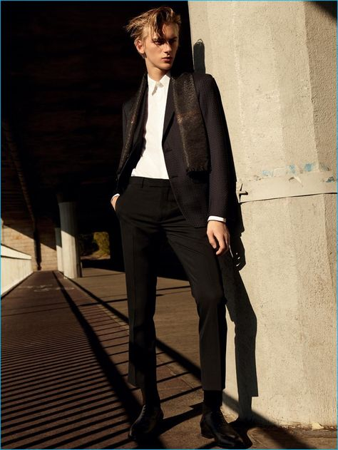 Model Dominik Sadoch dons a formal look from Ermenegildo Zegna Couture with Dior Homme trousers.