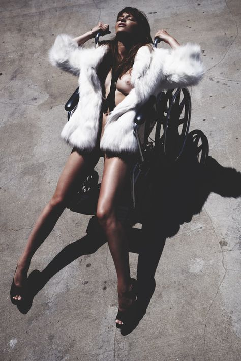 fashion editorial | posing | fur | wheel chair | legs | sexy | hot | heels |