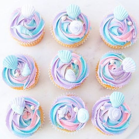 In love with these #mermaidcupcakes May from @sweets_withlove created for a #mermaidparty I organised on weekend. #pastelcupcakes #1stbirthday #1stbirthdayparty #girlsbirthday #splishsplashmermaidbash