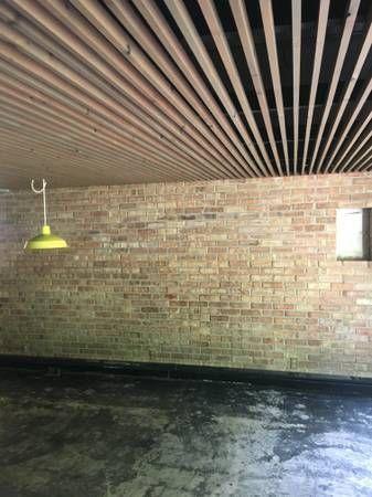 Slatted Ceiling In Basement Joists Cables Pipes And Subfloor Painted Black With Furring S Plafonds De Sous Sol Renovation De Sous Sol Relooking De Sous Sol