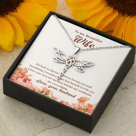 """DESCRIPTION Dragonflies are amazing creatures. They are strong, swift, and can adapt to changes effortlessly. Give this empowering and elegant necklace to your loved one, or yourself, to be reminded of the amazing shared qualities of the Dragonfly. This beautifully styled Dragonfly pendant is crafted from polished stainless steel and finished with a rose gold heart. A lovely piece that is sure to enhance any outfit. MATERIALS & SIZE Pendant size: 1.2"""" x 1.5"""" (30mm x 39mm) Adjustable cable ch"""