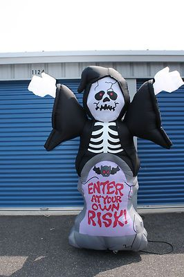 Grim-Reaper-with-Enter-at-your-own-risk-sign-Halloween-Inflatable-Yard-Decor