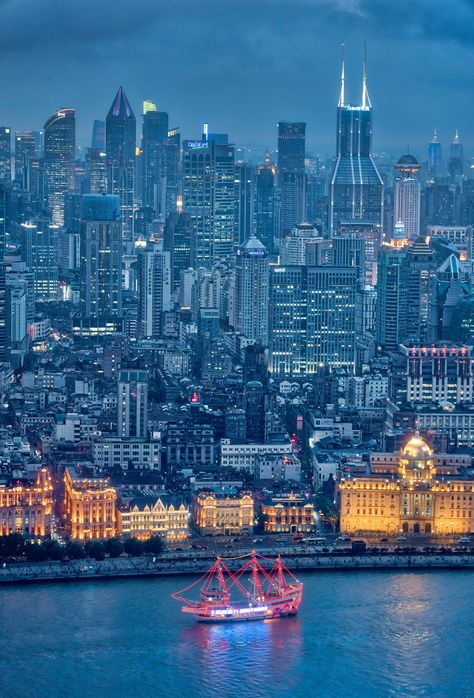 Here's a view of Shanghai that shows the infinite sprawl of buildings behind The Bund, which is that lit up area along the coast. That's leftover from the old British colonial days... we had a great photowalk along there too! 🙂 #TreyRatcliff #Shanghai #China #Bund #TheBund #HDR #Cityscape