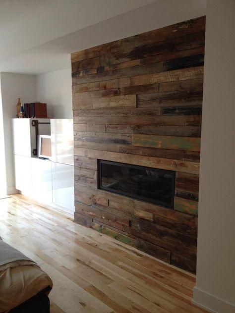 Custom reclaimed wood fireplace. ...