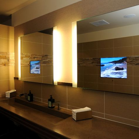 You can now include a TV in your bathroom without being worried about the space.  The patented mirror technology that the company uses produces a clear picture from the LCD when it's on and, because of the mirror, you won't even notice the TV when it's off.