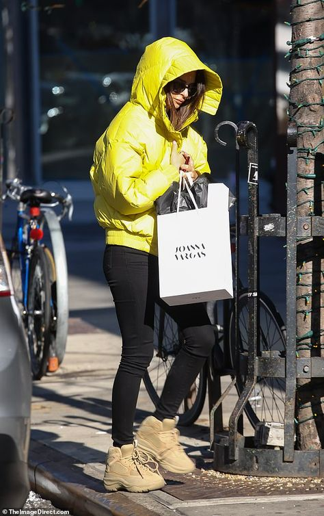 Emily Ratajkowski stays warm in neon