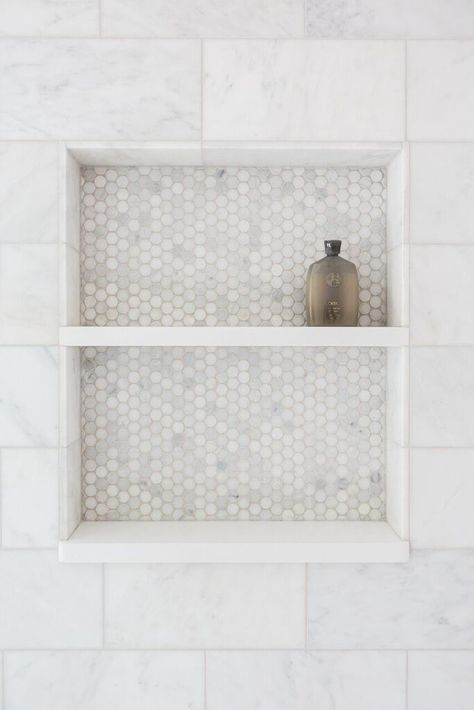 Bathroom Decor marble Love the detail in this master bathroom. We added a hexagon marble tile to the custom shower niche. It is a nice juxtaposition to the classic marble subway tile that is throughout the rest of the bathroom. Upstairs Bathrooms, Laundry In Bathroom, Master Bathroom, Bathroom Niche, Bathroom Ideas, Remodled Bathrooms, Bathroom Tub Shower, Tub Shower Combo, Marble Bathrooms