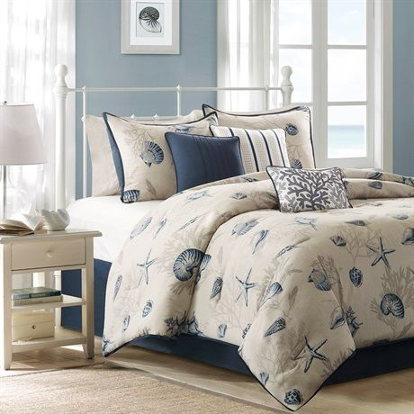 Create a coastal getaway right in your bedroom with the Bayside Comforter Collection. Made from 200 thread count cotton sateen, the comforter and shams feature assorted seashells accentuated with light and dark blue coloring on an ivory baackground. In a deep taupe color, a coral motif is printed on the background to give another dimension to this pattern. The reverse of both the comforter and shams is the same corresponding dark blue from the face. Three decorative pillows use pleating and ...