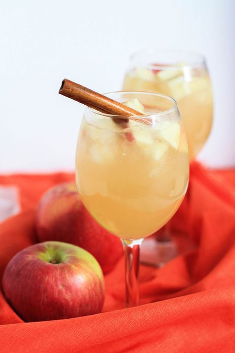 Apple Cider Sangria - 1 bottle Moscato wine, 1 cup light rum, 1.5 cups apple cider, 1 cup ginger ale, apple slices, ice