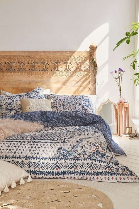 25 Bohemian Bedroom Decor Ideas That Will Make You Want to RedecorateASAP | Natural wood + vintage boho textiles | @stylecaster