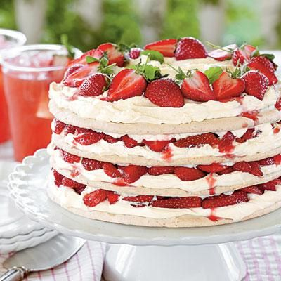 Fresh Strawberry Meringue Cake | Securing parchment paper with masking tape (it won't melt at the low temp) makes it easy to spread picture-perfect layers of meringue. | #Recipes | SouthernLiving.com
