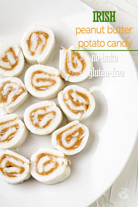 This Irish no-bake potato candy with a wonderful salty-sweet combination is an old fashioned recipe that's been passed down for generations. It's gluten free and combines only three ingredients: one mashed potato, powdered sugar, and a layer of peanut butter. The dough is then rolled into a log and cut like pinwheels.   #allthatsjas   #potatocandy #candy #dessert #allthatsjas #recipes #fromscratch #potato #peanutbutter #easy #glutenfree #nobake #Irish #StPatricksDay