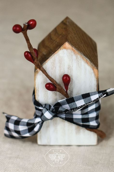 These darling handmade little mini wooden house place card holders are a wonderful addition to your place setting, food buffet or rustic farmhouse style wedding event. They are handmade of pine, sanded, stained and whitewashed on the front. There is a slit at the top of each house to insert a place card, special quote or even a photo if you'd like. Click through to see these little wood houses and display ideas! #miniwoodhouses#placecardholders