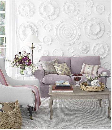 DIY CRAFTS Country Living came up with the brilliant idea to use ceiling medallions as a wall treatment.