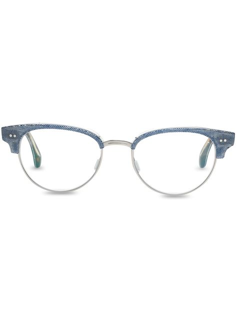 This style of the Audra design from #TOMSeyewear features chambray fabric has been layered in between the acetate frame.