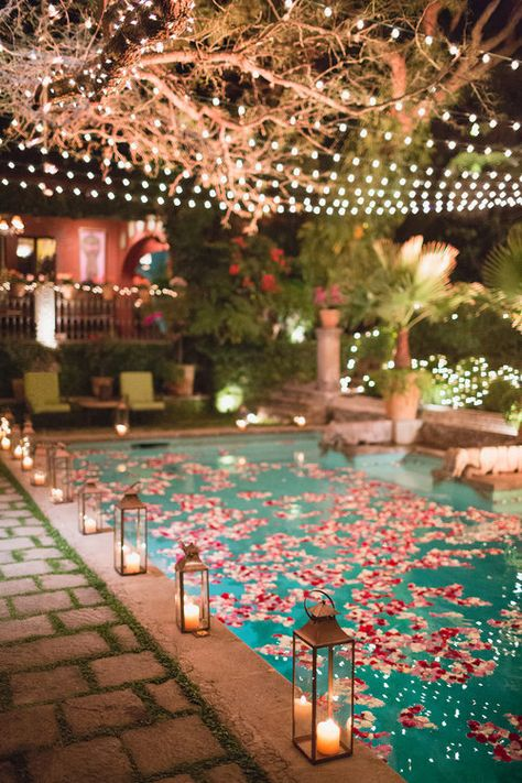 poolside reception anyone how gorgeous is this petal laced pool with string lights and lanterns Poolside reception anyone? How gorgeous is this petal laced pool with string lights and lanterns ? Pool Wedding Decorations, Floating Pool Decorations, Stage Decorations, Floating Lights In Pool, 30th Birthday Decorations, Backyard Wedding Pool, Outdoor Wedding Canopy, Garden Party Wedding, Sommer Pool Party