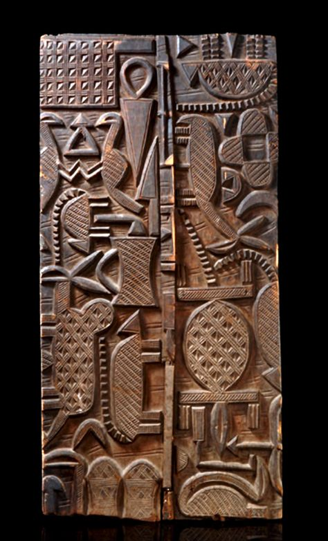 Africa | Door from the Nupe people of Nigeria | Light brown wood with dark brown patina.  Consists of two panels | A work of Sakiwa the younger, from Lapai