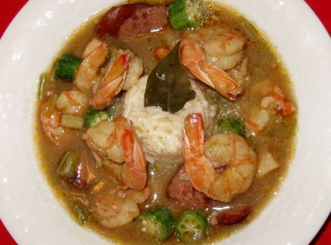 Cajun Gumbo,  : Millie's Notes:  With gumbo you can use any meat you want.The foundation of any great Gumbo is the Roux. One thing that is in every great gumbo is okra. It is the thickener for the dish. If you live where okra is hard to find just sub. with a corn starch slurry added right before you add the shrimp. Gumbo is traditionally served over rice. I know this is a long recipe, but it is so worth the time and effort!