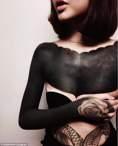 Darkness be my friend: 'Blackout' tattoos, where large areas of skin are tattooed solid black, are becoming more popular for those committed to ink