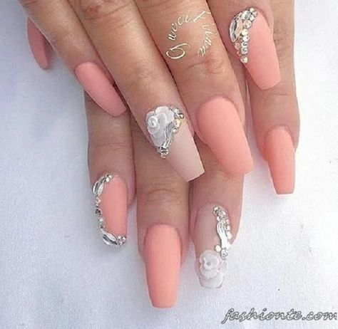 Very fresh looking summer nail art design. The melon coated nails simply look amazing while there are beautiful silver embellishments and beads added on top to complete the wonderful effect.