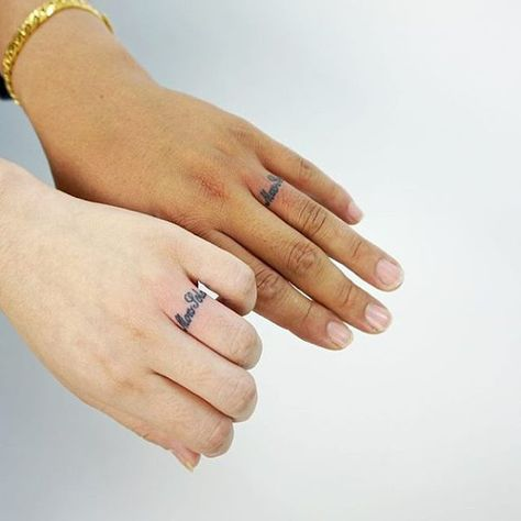 two left hands with wedding ring tattoo scipts