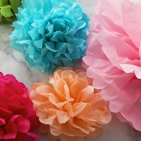 Learn how to make tissue paper flowers with the help of this step-by-step photo and video tutorial. This is your ultimate guide to making, hanging, and decorating with tissue paper flowers! So much helpful information all in one place. #tissuepaperflowers #paperflowers #crafts #partydecor