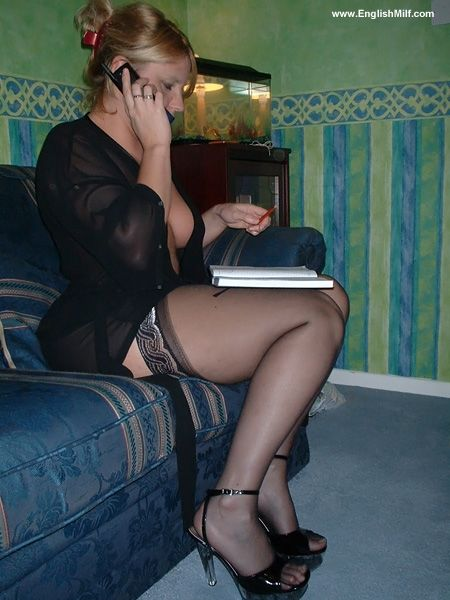 Busty British milf wife Daniella English in sheer robe, black stockings and heels ordering a pzza.