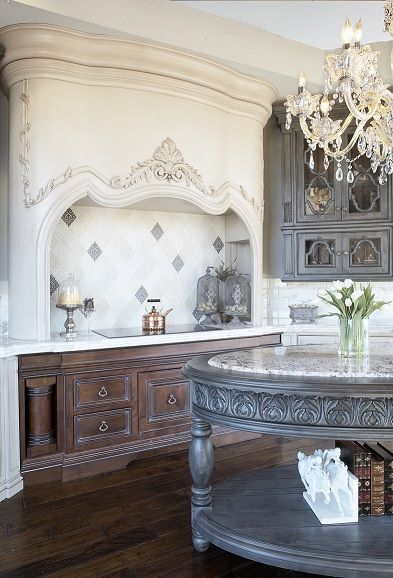 Elegant French Style Kitchen With A Gorgeous, Unique Hood Design And  Interesting Round Island!