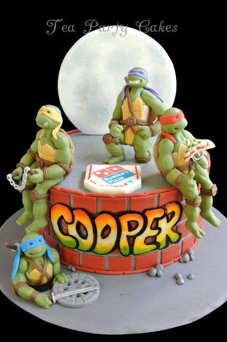 """I made this Teenage Mutant Ninja Turtles cake for my friend's son who is celebrating his 6th birthday this weekend. It's an 8 inch buttercream cake with fondant details and figures. I received a very sweet phone call from little Cooper thanking me for his """"cool"""" cake which made all the work that went into it so well worth it! :) TFL!"""