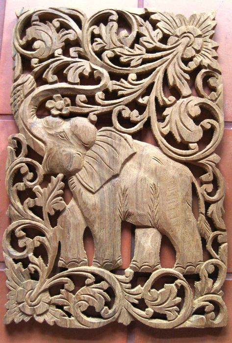 Add unique character to your space with these beautiful intricate hand carved teak wood panels.