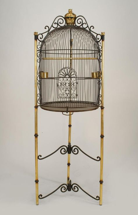 French Victorian style (20th Cent) black iron dome form bird cage supported on tripod base with 2 scroll design stretchers