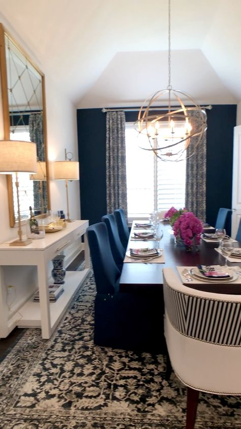 Beautiful dining room design with navy, white and gold accents.  Click to see more model home tour photos for decor inspiration... video by THE DECORATING COACH... Learn to decorate like a pro... #decoratingideas #decoratingtips #diningroom #diningroomideas #navyblue