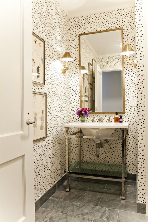 spotted walls in powder room, brass