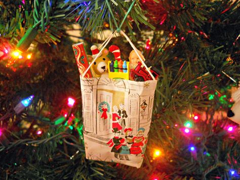 DIY Bag of Toys Christmas Ornaments made from leftover wrapping paper scraps.