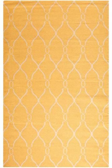 Yellow rug for nursery