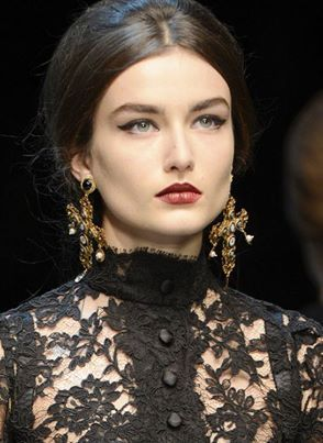 Dolce & Gabbana look to the treasures of Sciliy's Santa Maria Nuova de Monreale cathedral, with a new pair of Baroque cross earrings that mix heavy gold and gemstones the color of stained glass.