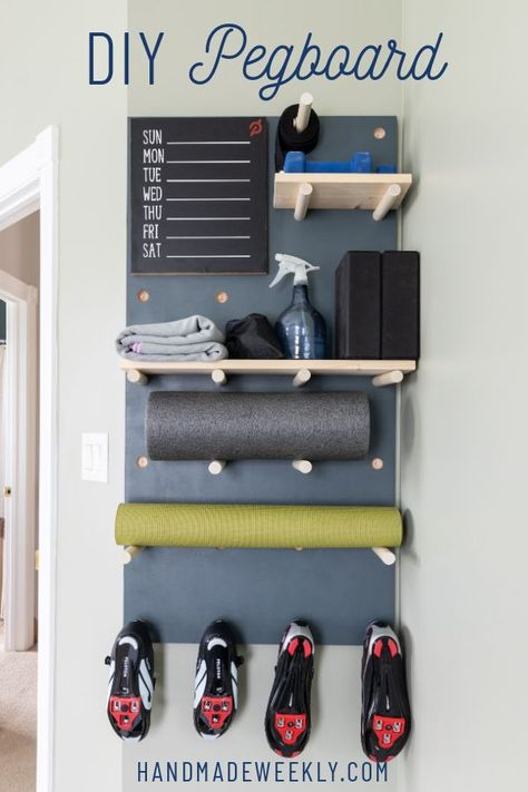 Tutorial for DIY giant pegboard using dowels. This versatile pegboard can be used to display sports equipment or other home decor. Cycling Shoes, Diy Home Gym, Gym Room At Home, Home Gym Decor, Basement Gym, Garage Gym, Basement Remodeling, Display Homes, Sports Equipment