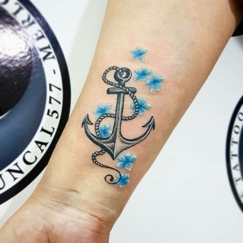 Tattoo ideas for women anchor on forearm with blue flowers #Tatto   #Tattoos