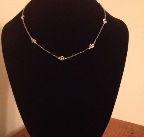 8 tiny French Cross charms spaced out on a chain necklace