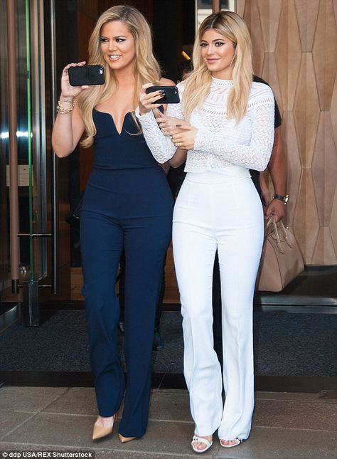 Blue and white: Khloe stepped out with sister Kendall Jenner, who also launched her paid website on Monday, including a video in which she denies having breast implants