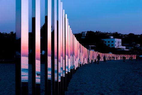 Quarter-Mile-Long Mirrored Poles Installation Reflects the Changing Tides