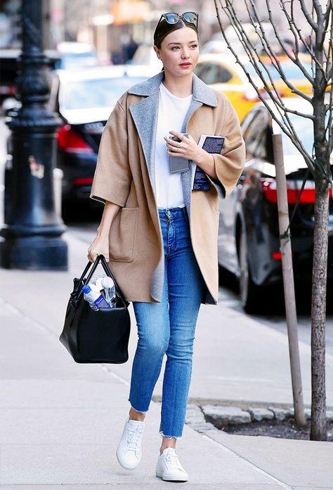 Miranda Kerr wears a coat + tee + skinnies + sneakers.